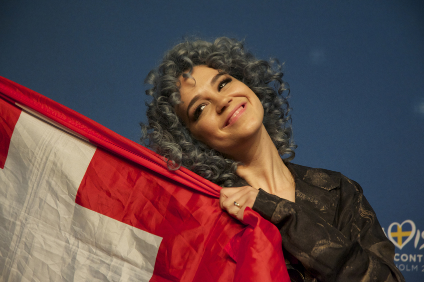 Rykka from Switzerland is proud of the flag